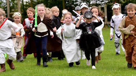 Children from Hethersett Woodside infant school dress as characters from Star Wars in memory of form