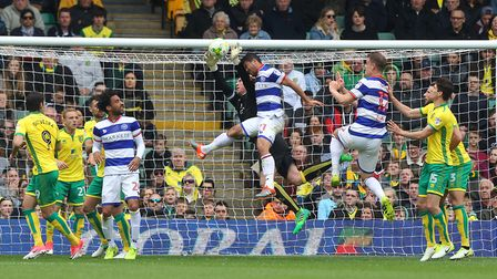 John Ruddy of Norwich collects the ball safely under pressure during the Sky Bet Championship match