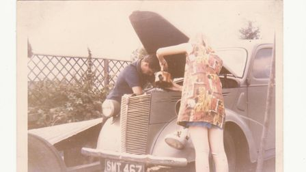 Carol Bailey and her future husband giving her 1947 Ford Prefect some weekly maintenance. Picture: s