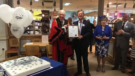 The mayor of Great Yarmouth, Malcolm Bird, presenting a plaque to Bruce Sturrock, chairman of Palmer
