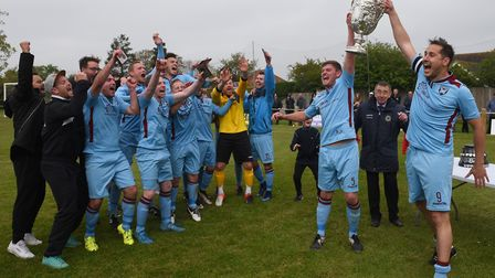 Harleston v Spixworth (blue) in the Anglian Combination Premier Division final. Spixworth celebrate