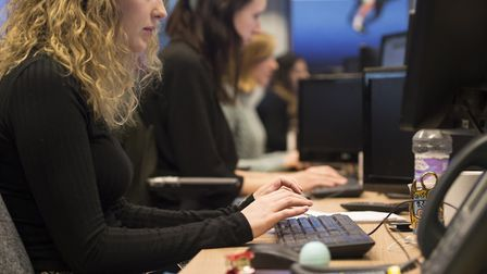 File photo of office workers at their desks as a report finds more people are turning to flexible an
