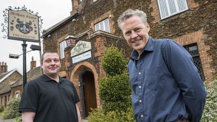 New owner of the Ffolkes Arms in Hillington Iain Wilson (right), with landlord Adam Chapman. Picture