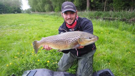 """Robbie Northman with one of the most stunning wild brown trout from an upper river for decades."""""""