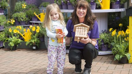 Three year old Sophie Fern meets plant expert Jackie Allen at Notcutts. Picture:Simon Dack/Vervate