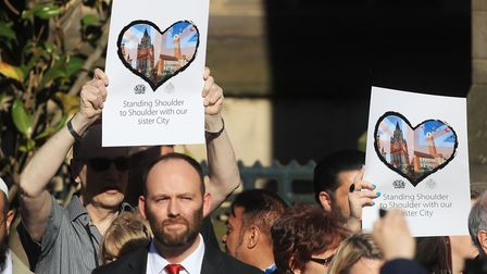 People gather for a vigil in Albert Square outside Manchester Town Hall in Manchester, after the sui