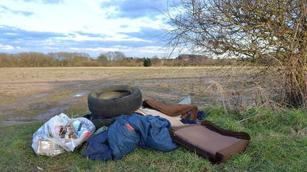 Tyres, cushions and bedding dumped on the edge of a field. Picture: Chris Bishop