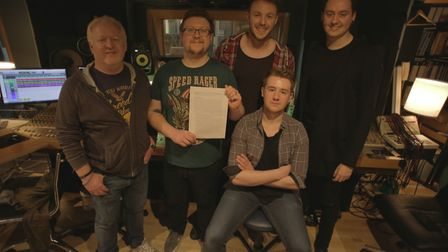 Members of Scream Serenity with band manager Simon Fennell and their music contract. Picture: Courte