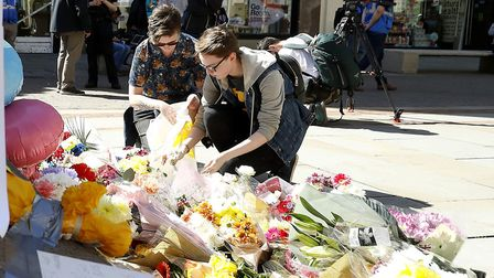 Members of the public leave floral tributes in St Annes Square, Manchester, after the terror attack