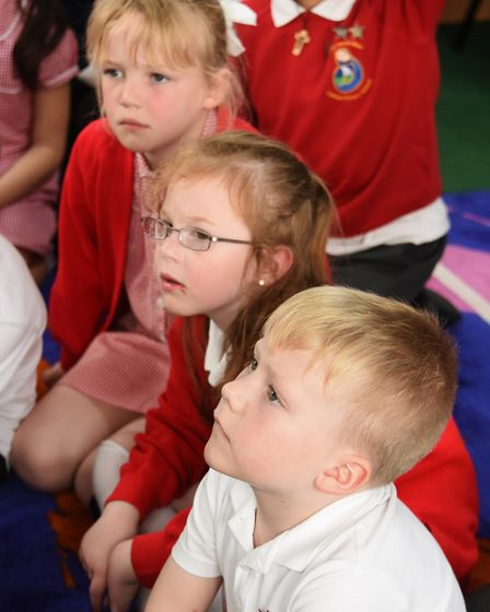 Pupils listen to a story at St Mary and St Peter Primary School at Gorleston in their new library. P