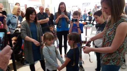 Haircuts for charity in the Castle Mall, Norwich. Photo: Deanne Mann