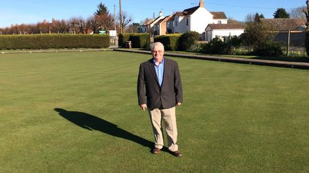 Brandon Town Bowling Club president John Kennedy on the green which has been repaired with help from