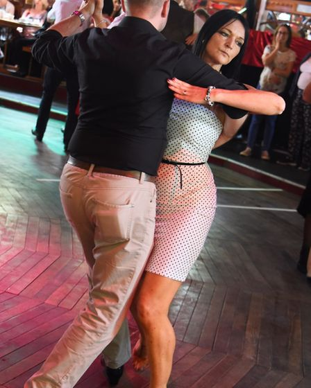 Dancers enjoying the tango at the Ragroof Tea Dance in the Adnams Spiegeltent for the Norfolk and No