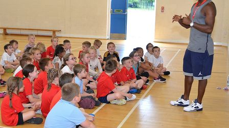 Rion Pierre speaks to pupils at Red Oak Primary School in Lowestoft. Pictures: Mick Howes