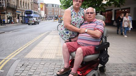 Eddie Pleban who was refused entry onto a First Bus because of his powered wheelchair. With him is h