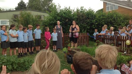 Students and staff at the opening of the redeveloped vegetable garden at Alburgh with Denton CE VC P
