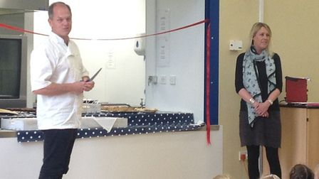 Chef Chris Coubrough, left, visited Stibbard school to officially open its new kitchen: Picture: Sti