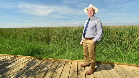 A new 700m boardwalk has been officially opened at Burgh Castle. Pictured is Martin Wilby, chairman