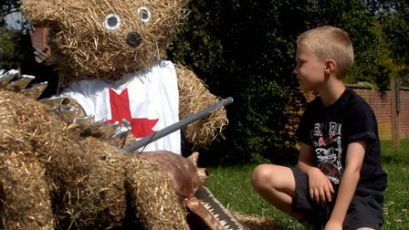 Adam Leamon, 6, admires the St George and Dragon teddy bears at a previous Great Ellingham Teddy Bea