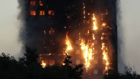 Smoke and flames rise from Grenfell Tower in London. Pic: AP Photo/Matt Dunham.