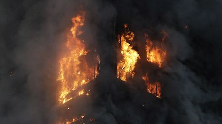 The fire tretches from the second to the 27th floor of the building. Pic: AP Photo/Matt Dunham.