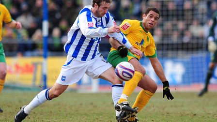 Darel Russell tangles with Brighton striker Glenn Murray. Picture: Alex Broadway/Focus Images