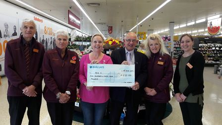 Claire Alden with supermarket colleagues presenting a cheque to the Big C. Picture: Linda Andrews