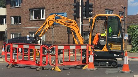 A digger gets to work following the appearance of a hole in Chapel Field North, Norwich. Picture: Na