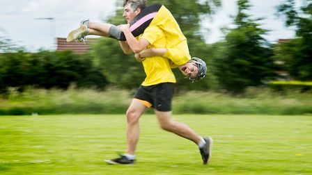 Scenes from the Norfolk Wife Carrying competiton held at The Downham Games 2017 - Winner's Robbie an