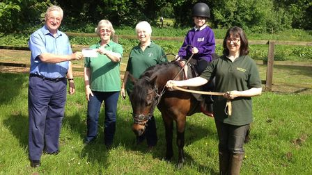 Anthony Bussell, left, with Susan Burton, Carolyn Webster, junior rider Faye on Popcorn, and Louise