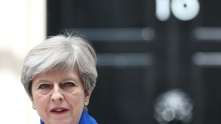 Prime Minister Theresa May makes a statement in Downing Street after she traveled to Buckingham Pal