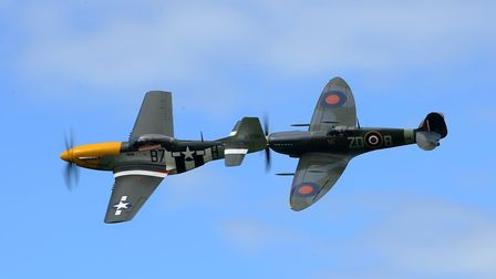 A P-51 Mustang (left) and Spitfire MkIX performs at the Old Buckenham Airshow.Photograph Simon Pa