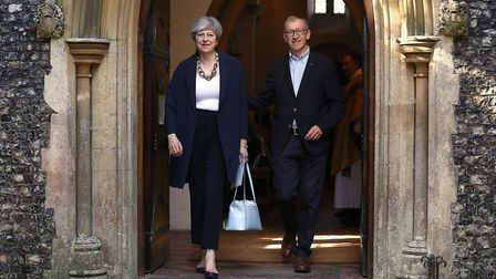 Prime Minister Theresa May and her husband Philip leave Holy Communion at St Andrew's Church in Sonn