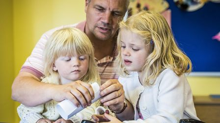 Gressenhall Fathers Day - Dad Kevin Moore with daughters Megan (4) and Sophie (6) making a paper car