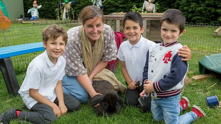 Beth Brais, centre, teaching assistant at Ashleigh Primary School with pupils learning outside on th