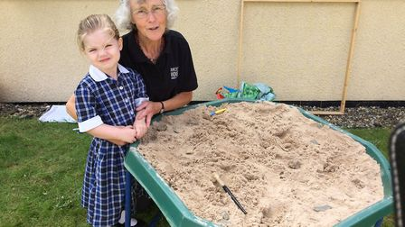 Four-year-old Mia and museum freelancer Jenny Hawker, searching for artefacts during Thetford Gramme