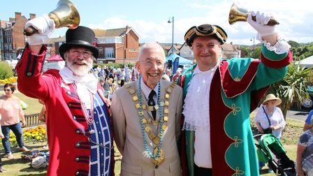 Sheringham Mayor David Gooch, centre, thanks outgoing Town Crier Tony Nelson, left, for his three d