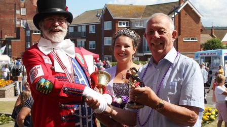 Sheringham carnvial queen Jade Roberts looks on as carnvial stalwart Eddie Page presents a porcelain
