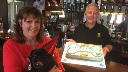 Captain the pug with owners Jo Fuller and Colin Oldham. Picture: David Hannant