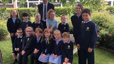 Woods Loke Primary School headteacher Joel Crawley with pupils as they celebrate their 'Good' Ofsted