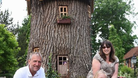 Neil and Jan Rafis, and their granddaughter Poppy Robinson, four, with Emily's House, the fairy tree