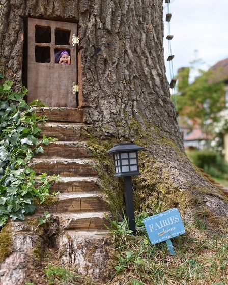 One of the doors and a welcome sign at Emily's House, the fairy tree in the front garden of Neil and
