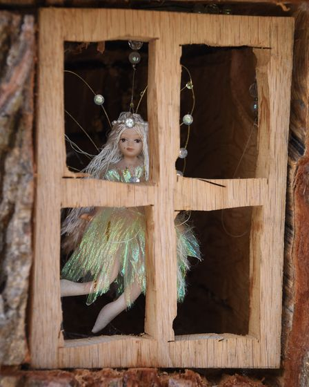 A fairy, donated by someone unknown, in one of the windows of Emily's House, the fairy tree in the f