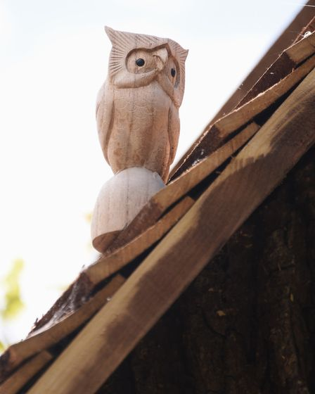 An owl on the roof of Emily's House, the fairy tree in the front garden of Neil and Jan Rafis at Wre