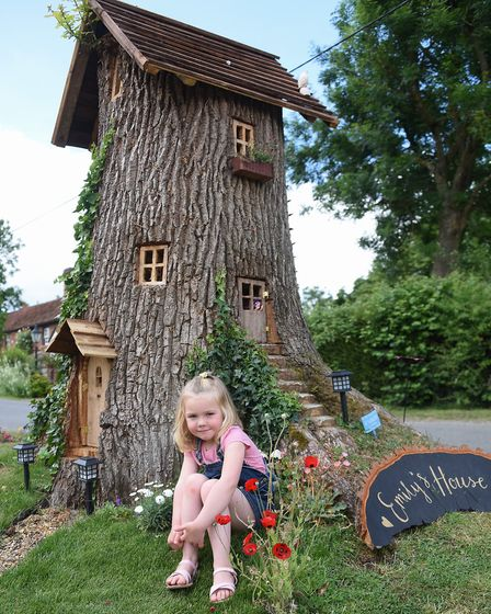 Poppy Robinson, 4, with Emily's House, the fairy tree in her grandad, Neil Rafis' front garden at Wr