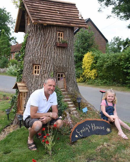 Neil Rafis, and his granddaughter Poppy Robinson, four, with Emily's House, the fairy tree in his fr