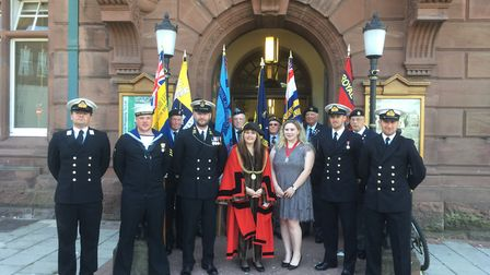 Great Yarmouth mayor Kerry Robinson-Payne is joined by military personnel at the flag unveiling. Pic