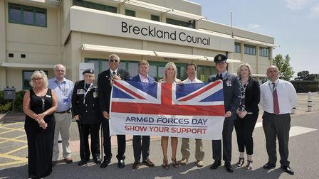 Breckland Council Chairman Kate Millbank (centre) with Cabinet members and senior staff at the raisi