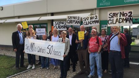 Protestors against a scheme of 50 homes in Mattishall protest with placards outside Breckland Counci