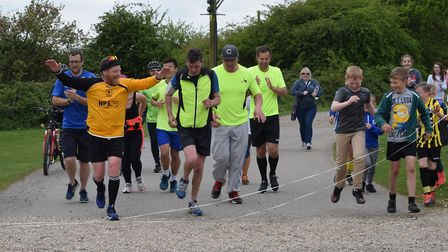 Mark Argent, with his arms raised finishes his run from King's Lynn to Fakenham. Picture: Fakenham T